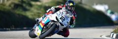 Bruce Anstey leaning hard into a corner on his Honda RCV213S at the Isle of Man TT