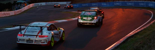 A Porsche 911 and Subaru WRX competing at dawn at the 2017 Bathurst 12 Hour