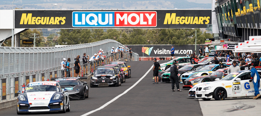 alt= Parked and Driving Supercars at the pitstop in Bathurst 12 hour""