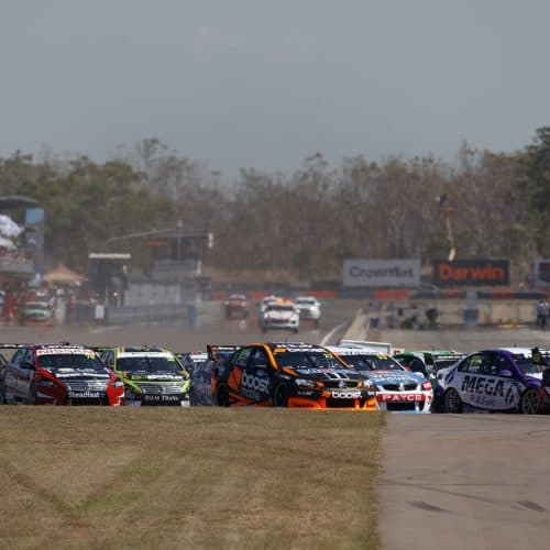"""alt=""""V8 superscars turning the corner at Darwin triple Crown racecourse"""""""