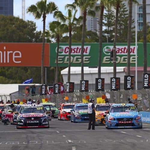 "alt=""V8 supercars driving down Gold Coast 600 racecourse"""