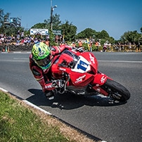 "alt=""Motorcycle rider riding at the Isle of Man TT"""