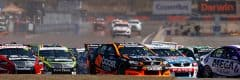 "alt=""Numerous supercars racing through Hidden Valley Raceway Course - 2019 CrownBet Darwin Triple Crown Travel Packages"""