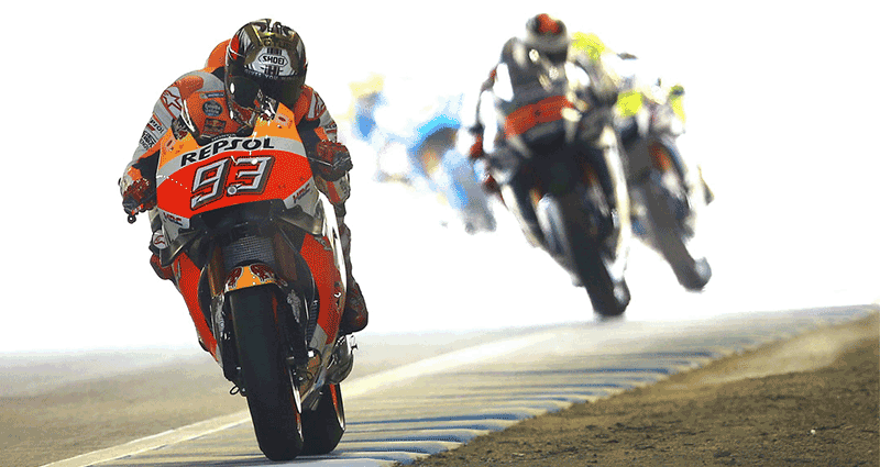 """alt=""""MotoGP riders racing though the Japanese Motorcycle Grand Prix at the Twin Ring Motegi"""""""