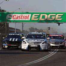 "alt="" V8 Supercars Driving along the track at the 2018 Watpac Townsville 400"""
