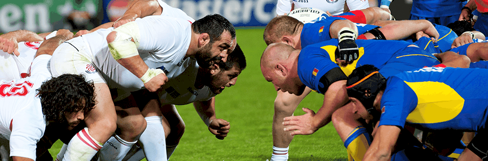 "alt=""Rugby Players getting ready to tackle each other at the Rugby World Cup 2015"""