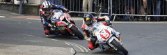 """alt=""""Two riders riding at the Isle of Man TT - Isle of Man TT 2019 Travel Packages"""""""