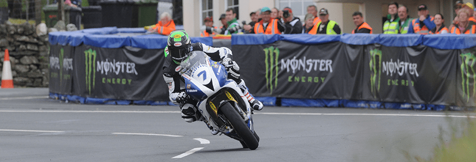 "alt=""Rider at the Isle of Man TT - Isle of Man TT 2019 Travel Packages"""