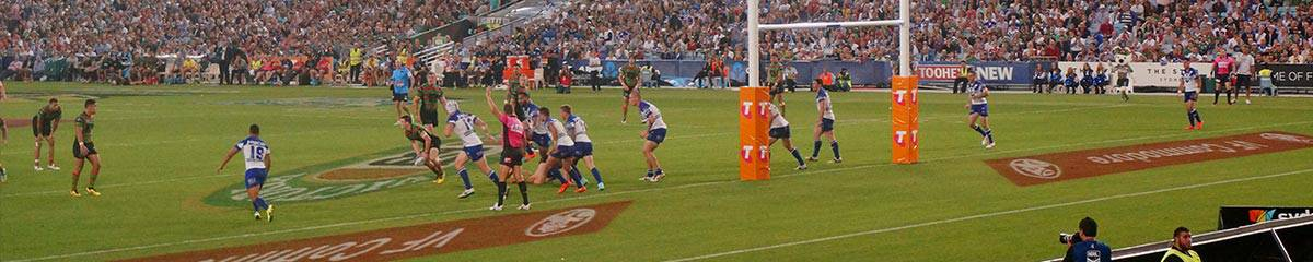 """alt=""""Landscape view of NRL Players competing at a famous NRL stadium - 2019 NRL USA Opening Match Travel Packages"""""""