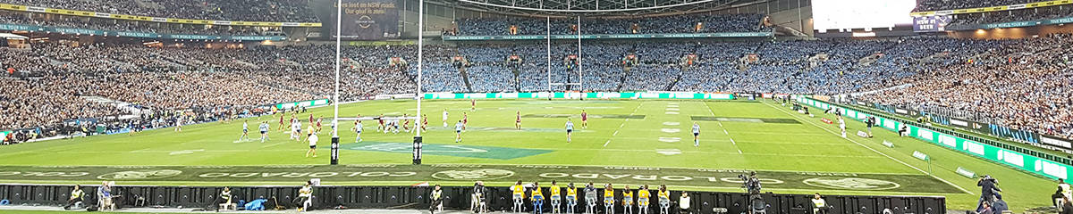 """alt=""""State of Origin Players playing at a World renowned Rugby League Stadium -2019 State of Origin, Brisbane Travel Packages"""""""