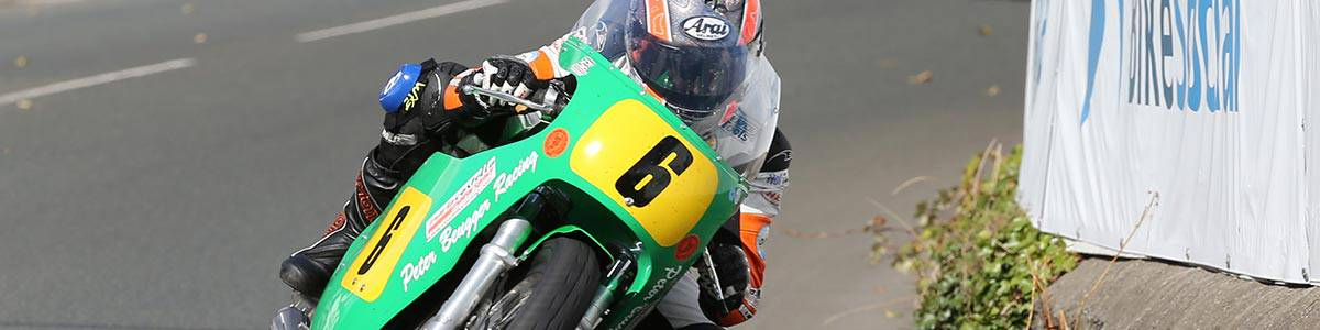 """alt=""""Rider turning the corner at Ulster Grand Prix - 2019 Ulster Grand Prix Travel Packages & Deals"""""""