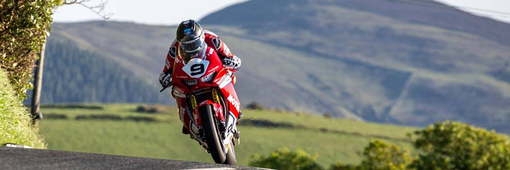 Davo Johnson riding over a crest at the Isle of Man TT 2020